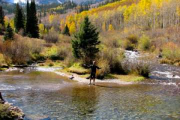 Fly fishing is a year-round sport in the Aspen/Snowmass area.  Photo courtesy Aspen Chamber Resort Association, Juan Grobler. (Pic)